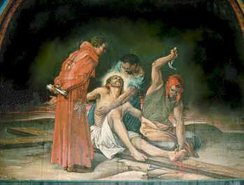 11- Jesús es clavado en la Cruz